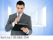Composite image of businessman with pen and clipboard. Стоковое фото, агентство Wavebreak Media / Фотобанк Лори