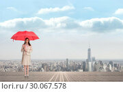 Купить «Composite image of attractive businesswoman holding red umbrella», фото № 30067578, снято 15 января 2014 г. (c) Wavebreak Media / Фотобанк Лори