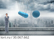 Composite image of smiling saleswoman in thoughts. Стоковое фото, агентство Wavebreak Media / Фотобанк Лори