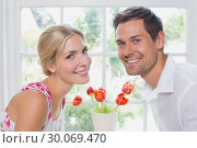 Купить «Portrait of a romantic young couple smiling», фото № 30069470, снято 5 декабря 2013 г. (c) Wavebreak Media / Фотобанк Лори