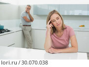 Купить «Couple not talking after an argument in kitchen», фото № 30070038, снято 18 октября 2013 г. (c) Wavebreak Media / Фотобанк Лори