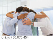 Купить «Business team with heads together forming a huddle», фото № 30070454, снято 19 декабря 2013 г. (c) Wavebreak Media / Фотобанк Лори