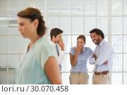 Купить «Colleagues gossiping with sad businesswoman in foreground», фото № 30070458, снято 19 декабря 2013 г. (c) Wavebreak Media / Фотобанк Лори