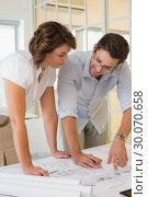 Купить «Business people working on blueprints at office», фото № 30070658, снято 19 декабря 2013 г. (c) Wavebreak Media / Фотобанк Лори