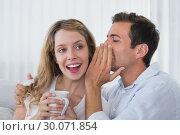 Купить «Man whispering secret into a cheerful young womans ear», фото № 30071854, снято 17 декабря 2013 г. (c) Wavebreak Media / Фотобанк Лори