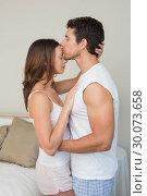 Купить «Loving man kissing womans forehead at home», фото № 30073658, снято 12 декабря 2013 г. (c) Wavebreak Media / Фотобанк Лори