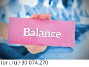 Купить «Woman holding pink card saying balance», фото № 30074270, снято 21 марта 2014 г. (c) Wavebreak Media / Фотобанк Лори