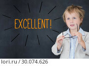 Купить «Excellent! against schoolboy and blackboard», фото № 30074626, снято 21 марта 2014 г. (c) Wavebreak Media / Фотобанк Лори