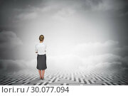 Купить «Composite image of thinking businesswoman», фото № 30077094, снято 25 марта 2014 г. (c) Wavebreak Media / Фотобанк Лори