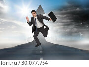 Купить «Composite image of cheerful businessman in a hurry», фото № 30077754, снято 25 марта 2014 г. (c) Wavebreak Media / Фотобанк Лори