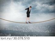 Купить «Composite image of businesswoman performing a balancing act», фото № 30078510, снято 28 марта 2014 г. (c) Wavebreak Media / Фотобанк Лори