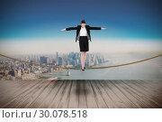Купить «Composite image of businesswoman performing a balancing act», фото № 30078518, снято 28 марта 2014 г. (c) Wavebreak Media / Фотобанк Лори