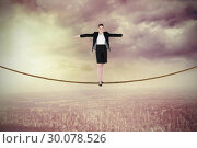 Купить «Composite image of businesswoman performing a balancing act», фото № 30078526, снято 28 марта 2014 г. (c) Wavebreak Media / Фотобанк Лори