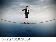 Купить «Composite image of businesswoman performing a balancing act», фото № 30078534, снято 28 марта 2014 г. (c) Wavebreak Media / Фотобанк Лори