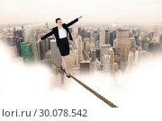 Купить «Composite image of businesswoman performing a balancing act», фото № 30078542, снято 28 марта 2014 г. (c) Wavebreak Media / Фотобанк Лори