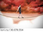Купить «Composite image of businesswoman doing a balancing act», фото № 30078554, снято 28 марта 2014 г. (c) Wavebreak Media / Фотобанк Лори