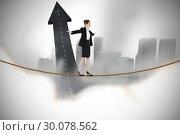 Купить «Composite image of businesswoman performing a balancing act», фото № 30078562, снято 28 марта 2014 г. (c) Wavebreak Media / Фотобанк Лори