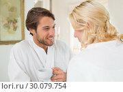 Купить «Cute couple in bathrobes having coffee together», фото № 30079754, снято 24 января 2014 г. (c) Wavebreak Media / Фотобанк Лори