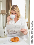 Купить «Pretty blonde in bathrobe drinking coffee and reading newspaper», фото № 30079762, снято 24 января 2014 г. (c) Wavebreak Media / Фотобанк Лори
