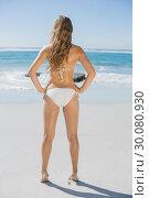 Купить «Fit woman in white bikini standing on beach», фото № 30080930, снято 12 февраля 2014 г. (c) Wavebreak Media / Фотобанк Лори