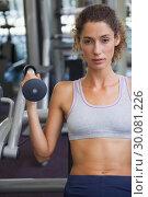 Купить «Fit woman using the weights machine for her arms », фото № 30081226, снято 26 февраля 2014 г. (c) Wavebreak Media / Фотобанк Лори