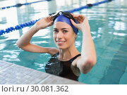 Купить «Fit swimmer in the pool smiling at camera», фото № 30081362, снято 26 февраля 2014 г. (c) Wavebreak Media / Фотобанк Лори