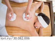 Купить «Smiling woman getting a back massage with herbal compresses», фото № 30082006, снято 9 апреля 2014 г. (c) Wavebreak Media / Фотобанк Лори