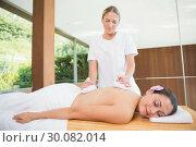 Купить «Smiling woman getting a back massage with herbal compresses», фото № 30082014, снято 9 апреля 2014 г. (c) Wavebreak Media / Фотобанк Лори