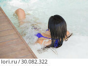 Купить «Brunette in bikini relaxing in hot tub», фото № 30082322, снято 8 апреля 2014 г. (c) Wavebreak Media / Фотобанк Лори