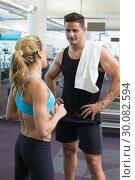 Купить «Bodybuilding man and woman talking together», фото № 30082594, снято 2 апреля 2014 г. (c) Wavebreak Media / Фотобанк Лори