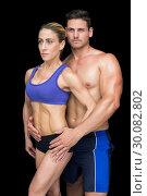 Купить «Fit bodybuilding couple posing together », фото № 30082802, снято 2 апреля 2014 г. (c) Wavebreak Media / Фотобанк Лори