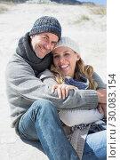 Купить «Attractive couple smiling at camera on the beach in warm clothing», фото № 30083154, снято 3 апреля 2014 г. (c) Wavebreak Media / Фотобанк Лори