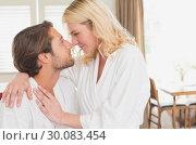 Купить «Couple having breakfast in their bathrobes », фото № 30083454, снято 24 января 2014 г. (c) Wavebreak Media / Фотобанк Лори