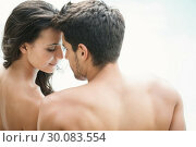 Купить «Attractive couple sitting poolside smiling», фото № 30083554, снято 29 января 2014 г. (c) Wavebreak Media / Фотобанк Лори