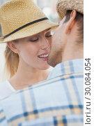 Купить «Young hip couple about to kiss», фото № 30084054, снято 19 февраля 2014 г. (c) Wavebreak Media / Фотобанк Лори