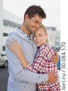 Купить «Hip young couple hugging in the road», фото № 30084170, снято 19 февраля 2014 г. (c) Wavebreak Media / Фотобанк Лори