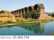 The ruins of an ancient aqueduct near the town of Aspendos (2017 год). Стоковое фото, фотограф Александр Клёнов / Фотобанк Лори