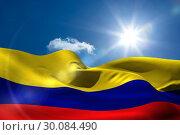 Купить «Colombia national flag under sunny sky», фото № 30084490, снято 27 мая 2014 г. (c) Wavebreak Media / Фотобанк Лори