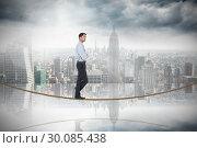 Купить «Composite image of serious asian businessman on tightrope», фото № 30085438, снято 11 июня 2014 г. (c) Wavebreak Media / Фотобанк Лори
