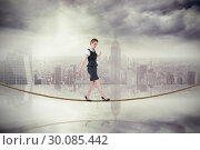 Купить «Composite image of businesswoman doing a balancing act on tightrope», фото № 30085442, снято 11 июня 2014 г. (c) Wavebreak Media / Фотобанк Лори