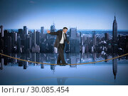 Купить «Composite image of mature businessman doing a balancing act on tightrope», фото № 30085454, снято 11 июня 2014 г. (c) Wavebreak Media / Фотобанк Лори