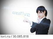 Купить «Businesswoman pointing to word creative», фото № 30085818, снято 11 июня 2014 г. (c) Wavebreak Media / Фотобанк Лори