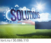 Businesswomans hand presenting the word solutions. Стоковое фото, агентство Wavebreak Media / Фотобанк Лори