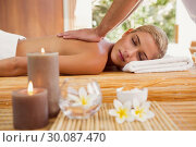 Купить «Woman receiving back massage at spa center», фото № 30087470, снято 8 апреля 2014 г. (c) Wavebreak Media / Фотобанк Лори