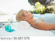 Купить «Beautiful woman lying on massage table at spa center», фото № 30087570, снято 8 апреля 2014 г. (c) Wavebreak Media / Фотобанк Лори