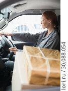 Купить «Delivery driver driving van with parcels on seat», фото № 30088054, снято 10 мая 2014 г. (c) Wavebreak Media / Фотобанк Лори