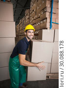Купить «Warehouse worker loading up a pallet », фото № 30088178, снято 10 мая 2014 г. (c) Wavebreak Media / Фотобанк Лори