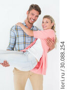 Купить «Young man carrying cheerful woman», фото № 30088254, снято 29 апреля 2014 г. (c) Wavebreak Media / Фотобанк Лори