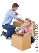 Купить «Young couple packing moving boxes», фото № 30088330, снято 29 апреля 2014 г. (c) Wavebreak Media / Фотобанк Лори