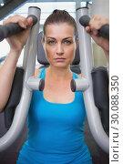 Купить «Fit brunette using weights machine for arms», фото № 30088350, снято 5 марта 2014 г. (c) Wavebreak Media / Фотобанк Лори